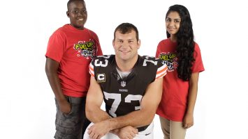 Martin Luther King Academy for Boys student Brandon Barkley (left) and Solon Middle School Student Izma Khaliq (right) pose with Browns offensive tackle Joe Thomas. Barkley, Khaliq and Thomas are featured in new educational videos from the American Dairy Association Mideast. Details: http://bit.ly/185EwFw
