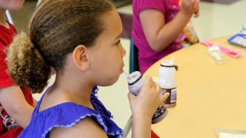 A student enjoys chocolate milk as a part of her school`s breakfast offering. While breakfast programs are not a new concept, research shows more students will eat school breakfast if served outside the cafeteria. Watkins Elementary School in Columbus, Ohio adopted breakfast-in-the-classroom and teachers have seen significant improvements from their students. The Ohio School Breakfast Challenge hopes to see more success stories like this. Click here for more: bit.ly/1Ex981U